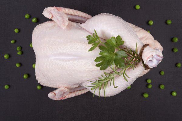 Raw whole chicken.